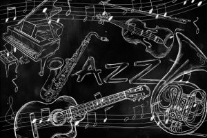 jazz-instruments-music-background-on-dark-blackboard_1379-292
